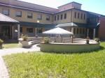 Due-Torri-San-Sisto-Bologna-entrance-patio-garden-shaded